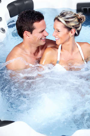 jacuzzi: Happy couple relaxing in hot tub. Vacation. Stock Photo