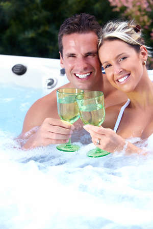 water hottub: Happy couple relaxing in hot tub. Vacation. Stock Photo