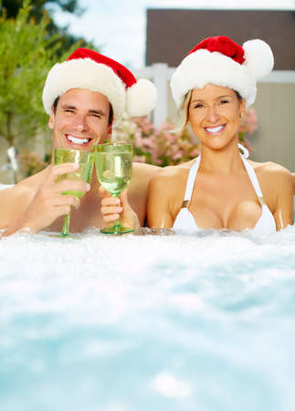 water hottub: Happy christmas santa couple in hot tub. Vacation.