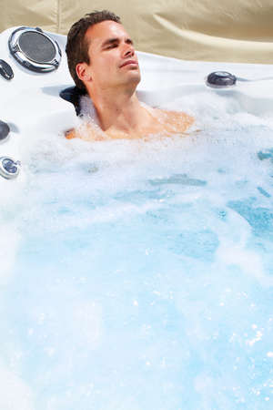 water hottub: Happy man relaxing in hot tub. Vacation.