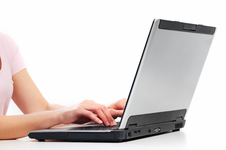Hands of business woman with laptop computer. Stock Photo - 21492843