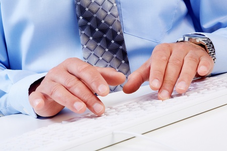 working on computer: Hands of businessman with a computer keyboard. Stock Photo