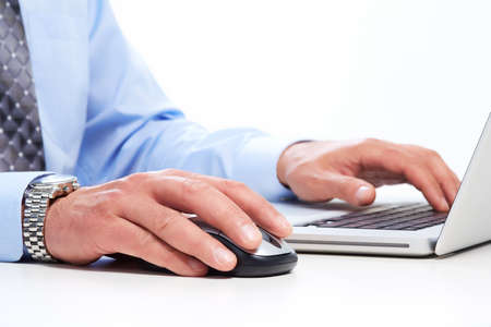 Hands of businessman with laptop. Technology and internet. photo