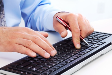 Hands of businessman with a computer keyboard. Stock Photo - 21492933