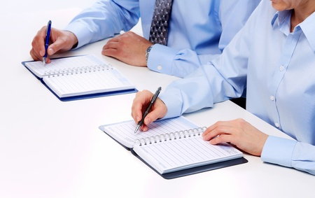 Hand with a pencil. Finance and accounting business background. Stock Photo