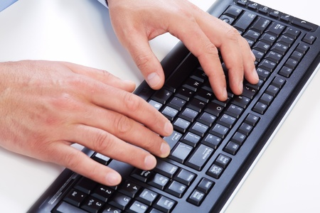 Hands of businessman with a computer keyboard. photo