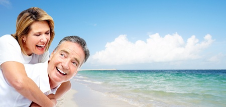 Happy senior couple on a tropical beach. Caribbean vacation resort. Stock Photo - 22106051