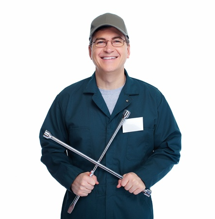 scheduled replacement: Auto mechanic with a wheel wrench. Isolated on white background.