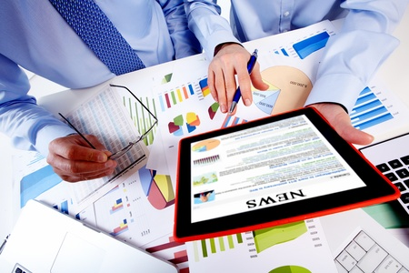 Hands with tablet computer. Finance and accounting business. photo
