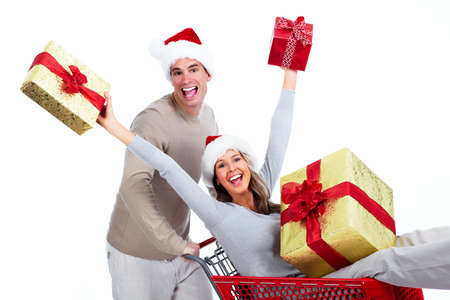 Happy young Christmas couple with  gifts isolated on white background. photo