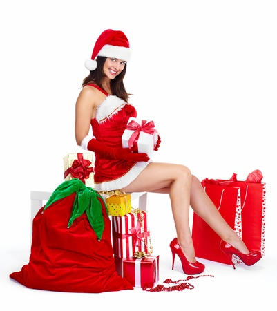 Beautiful Santa helper christmas girl with  gifts isolated on white background. photo