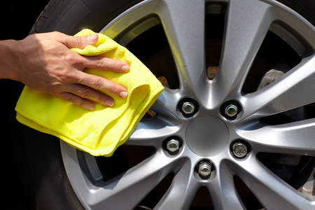 car wash: Hand with microfiber cloth cleaning car.