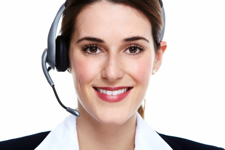 Business woman in headsets. Isolated over white background. Stock Photo - 22218230