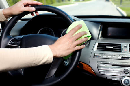 Hand with microfiber cloth cleaning car. photo