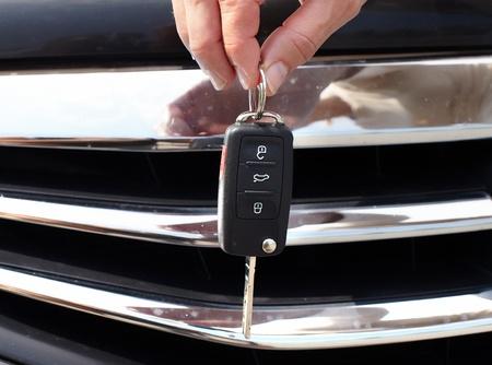 purchase: Car key. Auto dealership concept.