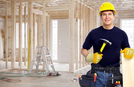 diy home repair: Handyman with a tool belt. House renovation service.