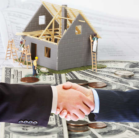 new development: Family house with money. Construction background. Stock Photo