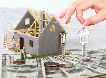 architecture detached house: Family house with money and key. Construction background. Stock Photo