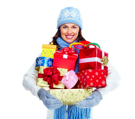 christmas shopping: Beautiful christmas girl with gifts isolated on white background.