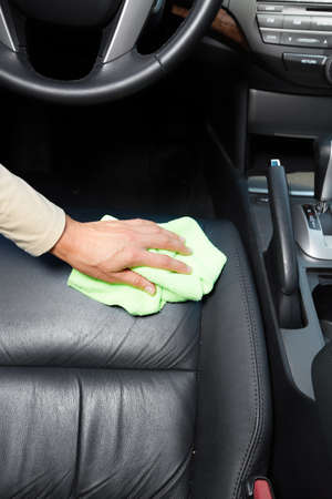 transport interior: Hand cleaning car seat. Stock Photo