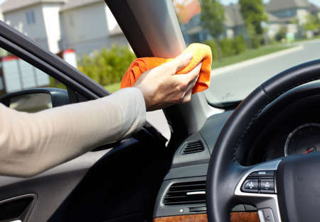 cleaning service: Hand with microfiber cloth cleaning car.