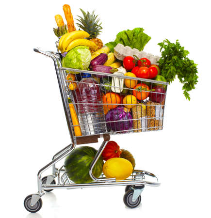 Full shopping grocery cart. Isolated on white background. photo