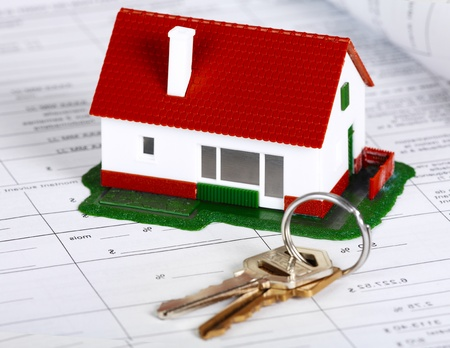 Family house with key. Real estate background. Stock Photo - 21757618
