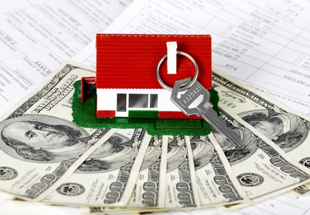 Family house with money and key. Real estate background. Stock Photo - 21757767