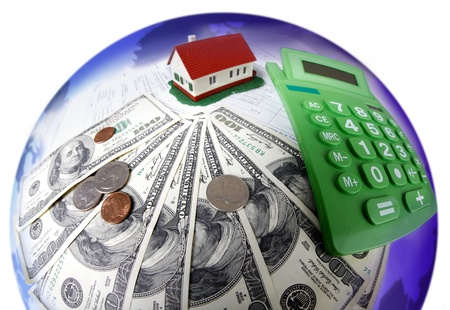 real world: House and calculator. Real estate concept background.
