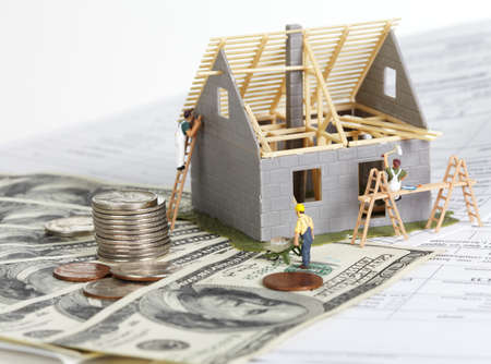 residential construction: Family house with money. Construction background. Stock Photo