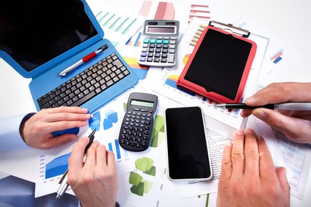 Hand with calculator. Finance and accounting business. photo