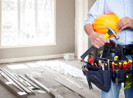 working belt: Handyman with a tool belt. House renovation service.