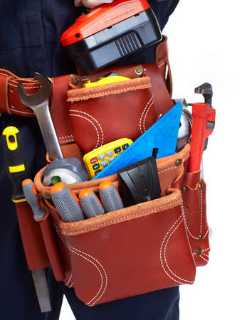 working belt: Handyman with a tool belt. Isolated on white background. Stock Photo