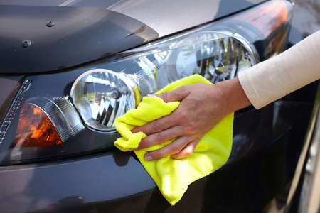 wash car: Hand with microfiber cloth cleaning car.