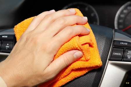 rags: Hand with microfiber cloth cleaning car.