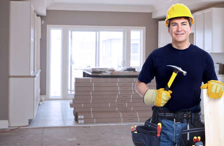 Handyman with a tool belt. House renovation service. photo