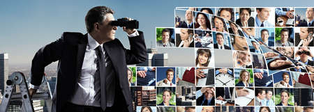 Businessman with binoculars  Search concept  photo