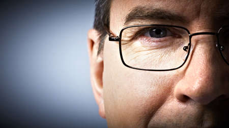 optician: Eye with glasses  Ophthalmologist  Stock Photo
