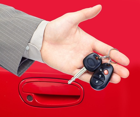 purchase: Car keys. Auto dealership concept.