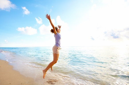 feeling happy: Woman running on Miami beach  Vacation  Stock Photo