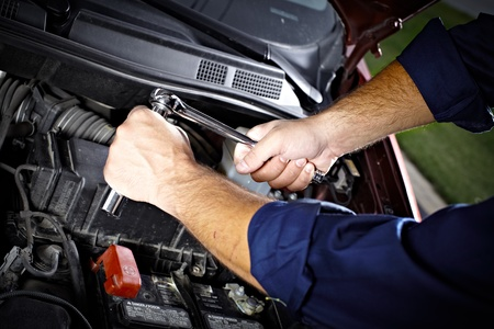 Auto mechanic working in garage. Repair service. Stock Photo - 21884157