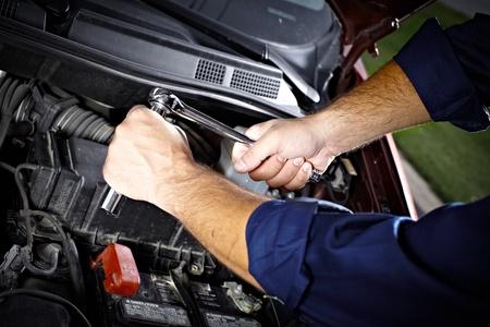 Auto mechanic working in garage. Repair service. Stock Photo - 21884157