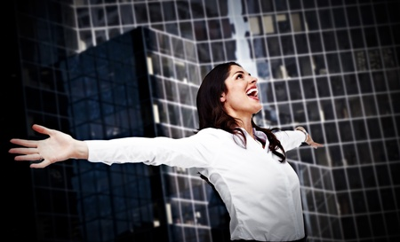Happy business woman on urban background  photo