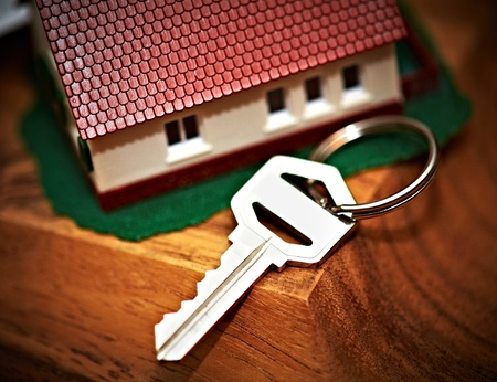 housebuilding: Family house with key. Real estate background.