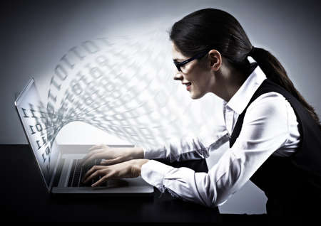 computer programmer: Woman working with laptop. Technology background.