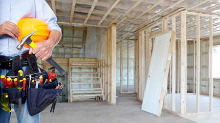 home renovations: Handyman with a tool belt  House renovation service