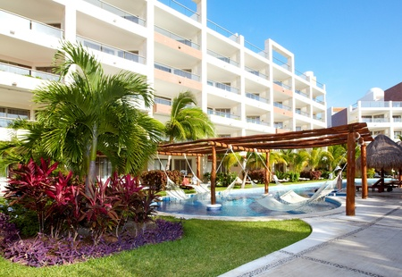 Swimming pool and hammock. Luxury exotic resort.
