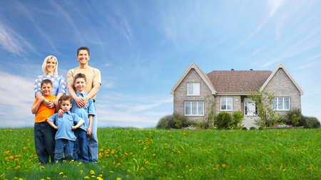 Happy family near new house  Real estate  photo