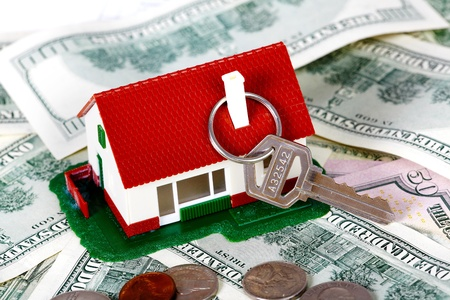 Family house with money and key  Real estate background  photo