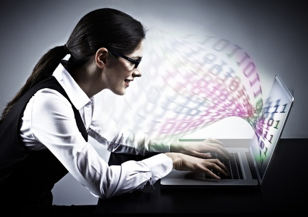 programmer: Woman working with laptop. Technology background.